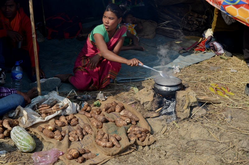 A tribal women cooking dish in the Mela ground